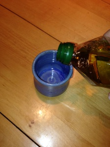 Fill cup or bowl with olive oil